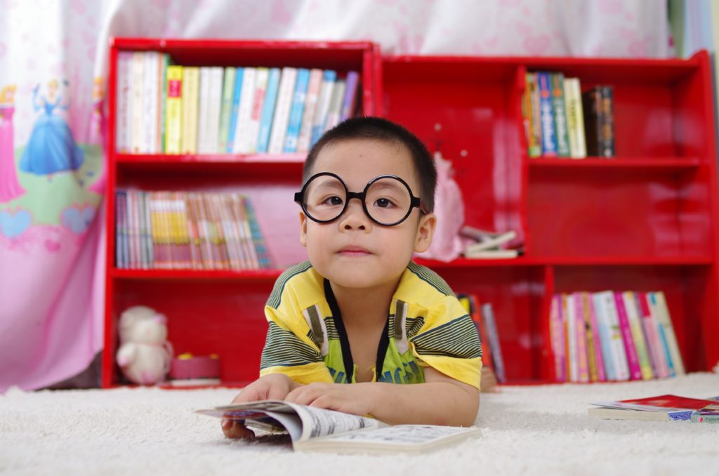 child with big glasses who loves science, activities that lead to a successful school year