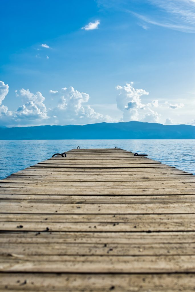 cottage dock with lake and blue sky, play while learning games and activities